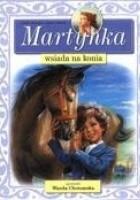 Martynka wsiada na konia