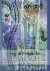 Okładka książki Oczy które płoną wschodzącym uśmiechem Bogdan Stangrodzki