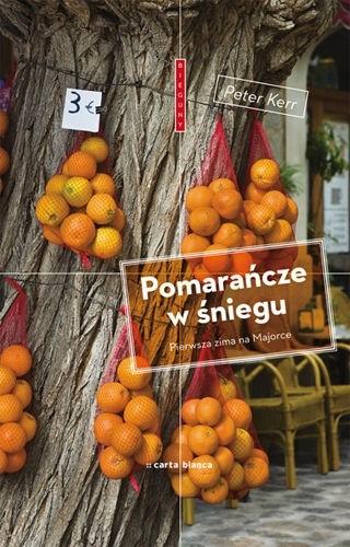 Okładka książki Pomarańcze w śniegu. Pierwsza zima na Majorce Peter Kerr